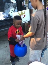 Even the iGen is helping the Power 77 Team pass out candy.