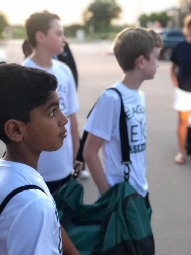 Elevate Your Game, Inc. (EYG) players listen to instructions prior to getting on the road to Clarksville, Texas for the basketball camp.